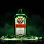 Jaegermeister bottle breaking through ice